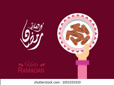 """Ahlan Ramadan"" Hello Ramadan month ..Hand holding a plate of dates..greeting card"