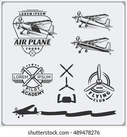 Airplane Club labels, emblems, badges and design elements. Vector monochrome illustration. Vintage style.