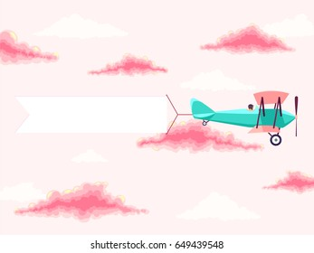 Airplane with pilot and advertising banner in the cloudy sky