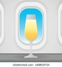 Airplane window with drinking glass