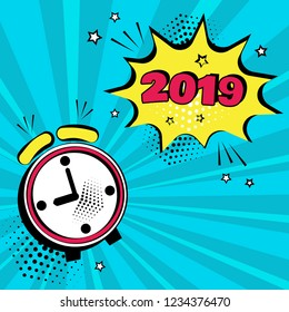 Alarm clock with yellow comic bubble with 2019 word on blue background. Comic sound effects in pop art style. Vector illustration.