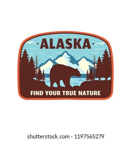 Alaska badge design. Mountain adventure patch. American travel logo. Cute retro style. Find your true nature custom quote. Bear walking through the forest. Stock vector emblem.