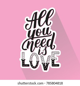All you need is love. Motivation quote with shaddow on pink background. Hand written phrase for prints and cards