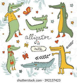 Alligator is cute. Colourful hand drawn set of crocodiles and alligators