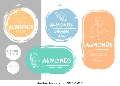 Almonds colorful label set. Raw organic almond nuts Badge shapes. Creative Nut tags. Raw food stickers ready for web and print. Painting brush style labels. Brush stroke badges in pastel colors.