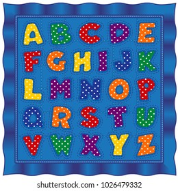 Alphabet baby quilt, old fashioned traditional patchwork design pattern, bright polka dot letters, blue satin border.
