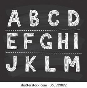 alphabet doodle on chalkboard background