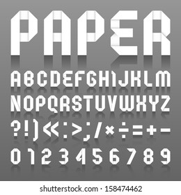 Alphabet folded of paper. Roman alphabet (A, B, C, D, E, F, G, H, I, J, K, L, M, N, O, P, Q, R, S, T, U, V, W, X, Y, Z) and Arabic numerals (0, 1, 2, 3, 4, 5, 6, 7, 8, 9).