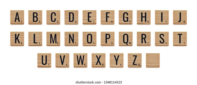 Alphabet letters on wooden pieces. Realistic vector illustration. Classic board game.