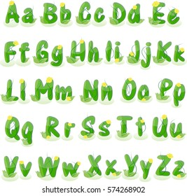 Alphabet made of green grass decorate with vine and flora isolated on white