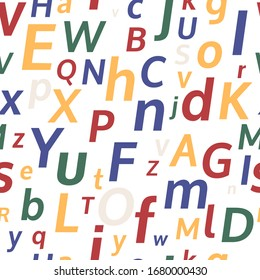 Alphabet seamless background.  Endless vector pattern with multicolored letters on a white background.
