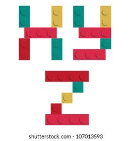 Alphabet set made of toy construction brick blocks isolated on white