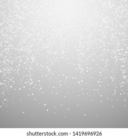 Amazing falling stars Christmas background. Subtle flying snow flakes and stars on light grey background. Bizarre winter silver snowflake overlay template. Alluring vector illustration.