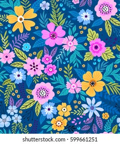Amazing seamless floral pattern with bright colorful flowers  and leaves on a blue background. The elegant the template for fashion prints. Modern floral background. Folk style