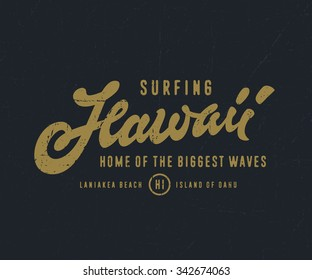Amazing Surfing Hawaii - Home of the Biggest Waves. Vintage Watercolor Hand lettered t shirt apparel fashion print. Retro old school tee graphics. Custom type design. Hand drawn typographic art.
