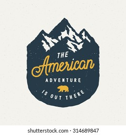 The American Adventure Is Out There Vintage Logo On Mountain Badge. Vector Illustration