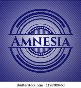 Amnesia badge with denim background
