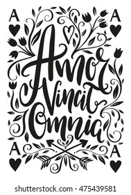Amor vincit omnia lettering design - Love conquers all. Unique creative hand drawn lettering design. Typographic poster or tattoo illustration. Popular Latin phrase.