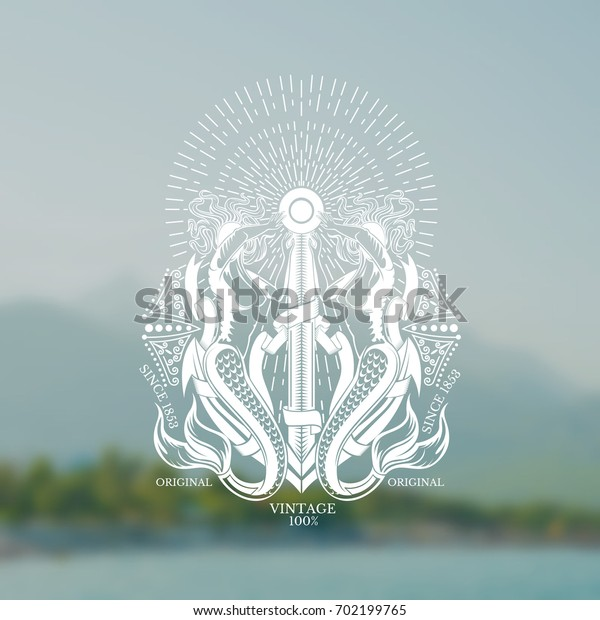 Anchor between two mermaids who closed face from bright rays. Marine label on blurred photo background