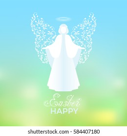 Angel with ornamental white wings and glowing nimbus. Beautiful angel silhouette with delicate wings. Happy Easter calligraphy text on a background of sky and green abstract background.