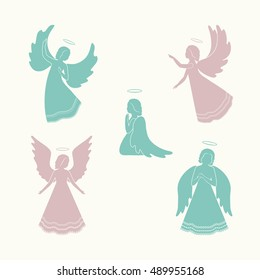Angels with simple wings and nimbus on a light background. Beautiful applique. Abstract design. Pink and green silhouettes. Isolated angel figurines.