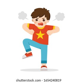 Angry expression. The boy is expressing anger. Angry child standing in a pose frowning, screaming, grinning and pumping fists. Bullying child.