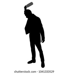 An angry man with a bottle of alcohol, silhouette