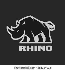 Angry rhino. Monochrome logo on a dark background.