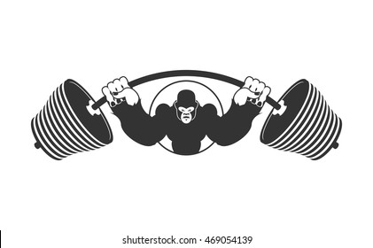 Angry strong Gorilla and  Barbell. athlete Aggressive big monkey. evil wild animal bodybuilder. logo for sports team