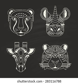Animal portraits made in unique geometrical flat style. Vector heads of cheetah, rhino, giraffe and tiger on chalkboard. Isolated icons for your design.