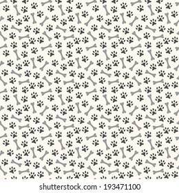 Animal seamless vector pattern of paw footprint and bone. Endless texture can be used for printing onto fabric, web page background and paper or invitation. Dog style. White and black colors.