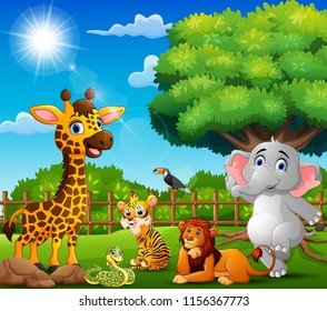 The animals are enjoying nature by a fence
