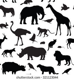 Animals silhouette seamless pattern. Wildlife tiled textured background. African animals seamless pattern