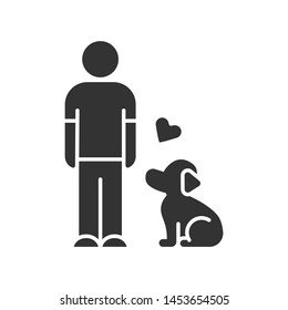 Animals welfare and help glyph icon. Pup and master. Pet adoption from shelter. Volunteer activity. Man with faithful dog. Silhouette symbol. Negative space. Vector isolated illustration