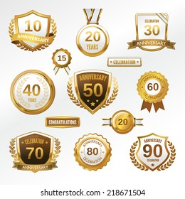 Anniversary celebration golden labels and badges set isolated vector illustration
