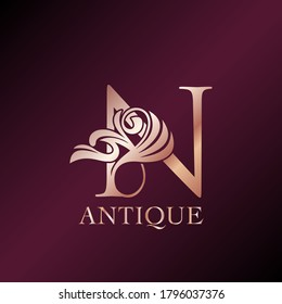 Antique Letter N Initial  Logo Elegance Gold Rose Luxury Ornate Deco Swirl Shape Template Design.