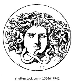Antique Patera Medusa Head is design comes from the center of a dish, vintage line drawing or engraving illustration.