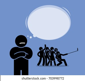 Antisocial or Anti-Social. A man looking at a group of friends having fun but do not want to join them. He prefers to be alone and dislikes mingling around.