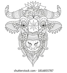Antistress coloring cow face, cow head. Beautiful decorative coloring book with different ornaments for coloring children and adults. Symbol of the New year 2021.
