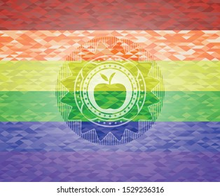 apple icon inside emblem on mosaic background with the colors of the LGBT flag