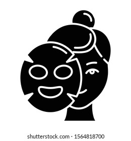 Applying sheet mask glyph icon. Skin care procedure. Hydrogen mask. Beauty treatment. Product for moisturizing. Cosmetics, makeup. Silhouette symbol. Negative space. Vector isolated illustration