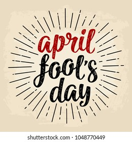 April fool's day calligraphic handwriting lettering. Vector black and red illustration isolated on a beige background. For web, poster