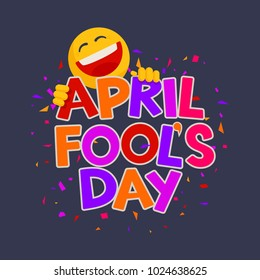 April Fools Day design with text and laughing smiley on a dark background