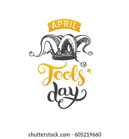 April Fools'day hand lettering greeting card. Vector festive calligraphy background with  jester hat illustration.