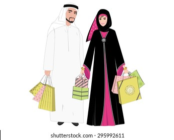 Arab couple shopping together - An Arab man and an Arab woman holding gifts and shopping bags