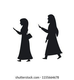 arab man and woman walking with smartphones texting silhouette