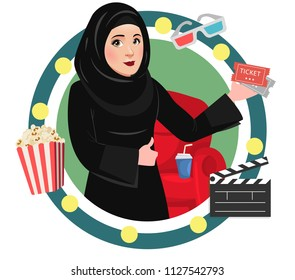 Arab Muslim Saudi Girl or Woman watching movie in a Cinema or Theater. Excited about new released film. Saudi Government has lifted the ban off cinemas in Saudi Arabia for entertainment.