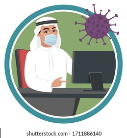 Arab muslim saudi man in office or working from home during corona virus crisis. Male receptionist sitting on a desk & chair, work from home on Computer in to prevent coronavirus covid19 in lockdown.