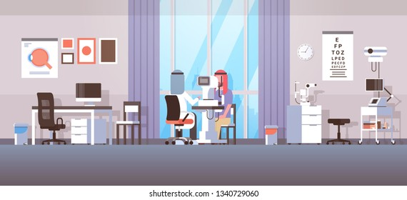 arab ophthalmologist checking patient vision arabic doctor in hijab and uniform making eye surgery laser correction medicine and healthcare concept oculists office interior horizontal