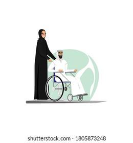 Arab woman carries a man in a wheelchair.